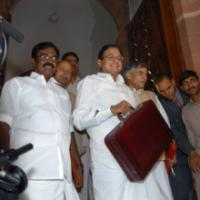 The Union Finance Minister, Shri P. Chidambaram posing for lens persons on his arrival at the Parliament to present the General Budget 2006-07, in New Delhi on February 28, 2006. The Minister of State (Revenue) Shri. S.S. Palanimanickam and the Minister of State (E,B &I) Shri Pawan Kumar Bansal are also seen