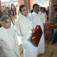 The Union Finance Minister, Shri P. Chidambaram arrives at the Parliament House to present the General Budget 2008-09, in New Delhi on February 29, 2008. The Minister of State (Revenue) Shri. S.S. Palanimanickam and the Minister of State (E, B&I) Shri Pawan Kumar Bansal are also seen