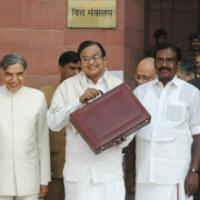 The Union Finance Minister, Shri P. Chidambaram leaving North Block for Parliament House to present the General Budget 2008-09, in New Delhi on February 29, 2008. The Minister of State (Revenue) Shri. S.S. Palanimanickam and the Minister of State (E, B&I) Shri Pawan Kumar Bansal are also seen
