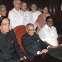 The Union Finance Minister, Shri Pranab Mukherjee giving final touches to the giving final touches to the General Budget 2009-10, in New Delhi on July 05, 2009. The Minister of State (Revenue), Shri. S.S. Palanimanickam, the Minister of State (E,B&I), Shri Namo Narain Meena and the Secretaries of the Ministry are also seen