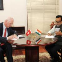 The Secretary, Department of Revenue, Dr. Hasmukh Adhia and the State Secretary for International Financial Matters of Switzerland, Mr. Jacques De Wattaville signing a Memorandum of Understanding (MoU), in New Delhi on June 15, 2016